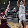 Enid's Abraham Rodriguez puts up a three point shot over Blackwell's Worthy Shepherd Friday January 18, 2019 at the Central National Bank Center. (Billy Hefton / Enid News & Eagle)