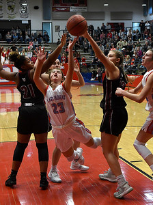 Chisholm's Briley Yunker scores a basket against Holland Hall's Johnna Orange and Gabby Gregory during the championship game of the Wheat Capital Tournament Saturday January 12, 2019 at Chisholm High School. (Billy Hefton / Enid News & Eagle)