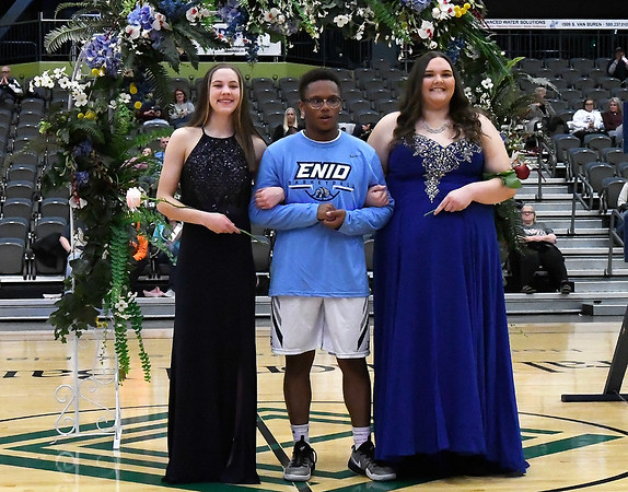 David Drake escorts Ashley Handing (left) and Emily Davis during the homecoming ceremony Friday January 18, 2019 at the Central National Bank Center. (Billy Hefton / Enid News & Eagle)
