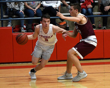 Chisholm's Kolten Childers drives pass Perry's Bryce Allen during a semi-final game of the Wheat Capital Tournament Friday January 11, 2019 at Chisholm High School. (Billy Hefton / Enid News & Eagle)