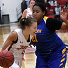 NOC Enid's Macie Jo Pierce drives towards the basket against Eastern Oklahoma's Britnee Gabriel Thursday January 24, 2019 at the NOC Mabee center. (Billy Hefton / Enid Nws & Eagle)
