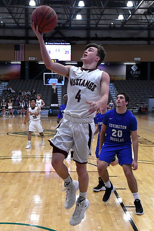 Pioneer's Ty Dennett gets around Covington-Douglas' Calab Dalrymple for a basket during the first round of the Skeltur Conference Tournament Thursday January 24, 2019 at the Central National Bank Center. (Billy Hefton / Enid News & Eagle)
