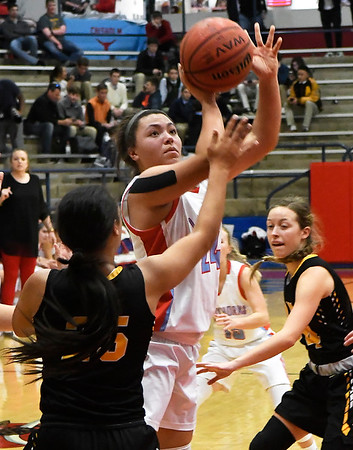 Chisholm's Tatum Long puts up a shot against Alva's Acacia Charles during the first round of the Wheat Capital Tournament Thursday January 10, 2019 at Chisholm High School. (Billy Hefton / Enid News & Eagle)