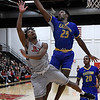 NOC Enid's Romio Harvey has his shot blocked by Eastern Oklahoma's Michael Turay Thursday January 24, 2019 at the NOC Mabee center. (Billy Hefton / Enid Nws & Eagle)