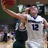 Hennessey's Bryan Villalobos takes a hand to the face from Thomas' Caleb Rainwater as he drives to the basket during the first round of the Three Rivers Tournament Thursday January 10, 2019 at the Central National Bank Center. (Billy Hefton / Enid News & Eagle)