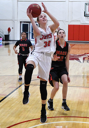 NOC Enid'sSarah Griswold scores a fastbreak basket against Mid American Monday January 7, 2019 at the NOC Mabee Center. (Billy Hefton / Enid News & Eagle)
