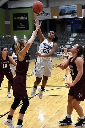 Enid's Mya Edwards puts up a shot over Blackwell's Madelyn Hanksins and Cady Smith Friday January 18, 2019 at the Central National Bank Center. (Billy Hefton / Enid News & Eagle)