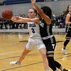 Lomega's Courtney Fox passes the ball out to a 3-point shooter while defended by Timberlake's Maegan Scobey during a semi-final game of the Cherokee Strip Conference Tournament Friday January 25, 2019 at the Chisholm Trail Expo Center. (Billy Hefton / Enid News & Eagle)