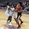 Enid's Mason Berry and Jadon Dimarucut try to trap Ponca City's Anthony Gazaway Tuesday January 15, 2019 at the Central National Bank Center. (Billy Hefton / Enid News & Eagle)