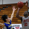 NOC Enid's SRayShawn Dotson shoots over Eastern Oklahoma's Jace Pratt Thursday January 24, 2019 at the NOC Mabee center. (Billy Hefton / Enid Nws & Eagle)