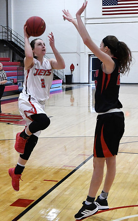NOC Enid's Jacie Engler goes up against Mid American's Sydney Wycoff Monday January 7, 2019 at the NOC Mabee Center. (Billy Hefton / Enid News & Eagle)