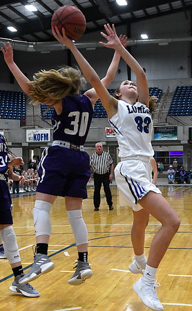Lomega's Emma Duffy gets behind Burlington's Anna Motycka for a basket during the championship game of the Cherokee Strip Conference Tournament Saturday january 26, 2019. (Billy Hefton / Enid News & Eagle)