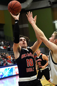 OBA's Luke Potter shoots over Thomas' Noah Rainwater during the Three Rivers Tournament Friday January 11, 2019 at the Central National Bank Center. (Billy Hefton / Enid News & Eagle)