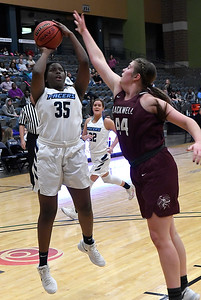 Enid's Niesha Fuston shoots over Blackwell's Lyndi Jobe Friday January 18, 2019 at the Central National Bank Center. (Billy Hefton / Enid News & Eagle)