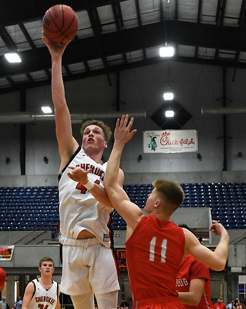 Cherokee's Blake Hall shoots over Ringwood's Reed Mason during the championship game of the Cherokee Strip Conference Tournament Saturday january 26, 2019. (Billy Hefton / Enid News & Eagle)