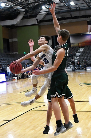 Hennessey's Angel Rodriguez goes against Thomas' Zach Selzer and Marshall Gose during the first round of the Three Rivers Tournament Thursday January 10, 2019 at the Central National Bank Center. (Billy Hefton / Enid News & Eagle)