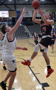 OBA's William Price shoots over Thomas' Marshall Gose during the Three Rivers Tournament Friday January 11, 2019 at the Central National Bank Center. (Billy Hefton / Enid News & Eagle)