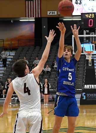 Covington-Douglas' Weston Carl shoots over Pioneer's Ty Dennett during the first round of the Skeltur Conference Tournament Thursday January 24, 2019 at the Central National Bank Center. (Billy Hefton / Enid News & Eagle)