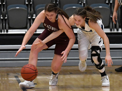 Enid's Ashley Handing and Blackwell's Lyndi Jobe go after a loose ball Friday January 18, 2019 at the Central National Bank Center. (Billy Hefton / Enid News & Eagle)