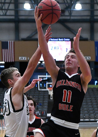 OBA's Garret Salyer shoots over Thomas' Noah Rainwater during the Three Rivers Tournament Friday January 11, 2019 at the Central National Bank Center. (Billy Hefton / Enid News & Eagle)
