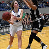 Lomega's Emma Duffy looks to pass the ball around Timberlake's Maegan Scobey during a semi-final game of the Cherokee Strip Conference Tournament Friday January 25, 2019 at the Chisholm Trail Expo Center. (Billy Hefton / Enid News & Eagle)