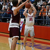 Chisholm's T.C. Smith puts up a three point shot over Perry's Mason Drake during a semi-final game of the Wheat Capital Tournament Friday January 11, 2019 at Chisholm High School. (Billy Hefton / Enid News & Eagle)