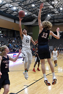 Enid's Carter Owens put supa  shot over Ponca City's Luke Seals Tuesday January 15, 2019 at the Central National Bank Center. (Billy Hefton / Enid News & Eagle)