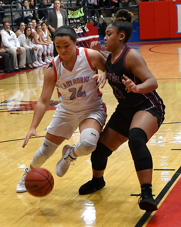 Chisholm's Tatum Long drives towards the basket against Holland Hall's Johnna Orange during the championship game of the Wheat Capital Tournament Saturday January 12, 2019 at Chisholm High School. (Billy Hefton / Enid News & Eagle)
