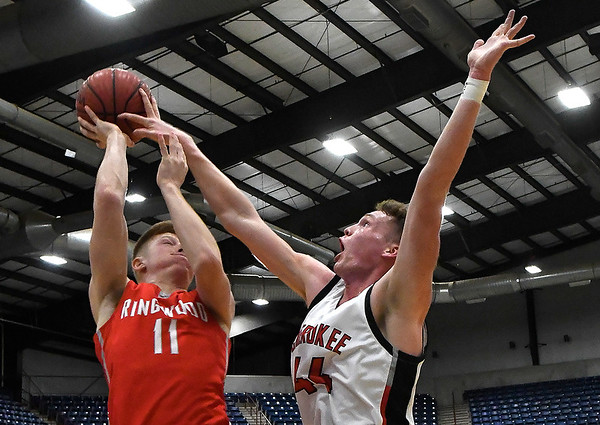 Cherokee's Blake Hall blocks the shot of Ringwood's Reed Mason during the championship game of the Cherokee Strip Conference Tournament Saturday january 26, 2019. (Billy Hefton / Enid News & Eagle)