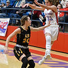 Chisholm's Briley Yunker makes a pass over Alva's Zoe Moorman during the first round of the Wheat Capital Tournament Thursday January 10, 2019 at Chisholm High School. (Billy Hefton / Enid News & Eagle)