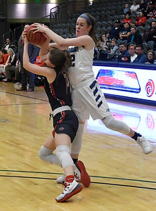Enid's Cayti Moeller tries to steal th eball from Ponca City's Karis Branstetter Tuesday January 15, 2019 at the Central National Bank Center. (Billy Hefton / Enid News & Eagle)