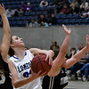 Lomega's Emma Duffy drives to the basket between Timberlake's Caitlyn Fargo and KaLynn FeForce during a semi-final game of the Cherokee Strip Conference Tournament Friday January 25, 2019 at the Chisholm Trail Expo Center. (Billy Hefton / Enid News & Eagle)