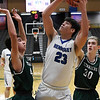 Hennessey's Hugo Rodriguez shoots over Thomas' Caleb Fernandez during the first round of the Three Rivers Tournament Thursday January 10, 2019 at the Central National Bank Center. (Billy Hefton / Enid News & Eagle)
