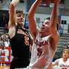 Chisholm's Kolten Childers goes to the basket against Fairview's Chad McGolden during the first round of the Wheat Capital Tournament Thursday January 10, 2019 at Chisholm High School. (Billy Hefton / Enid News & Eagle)