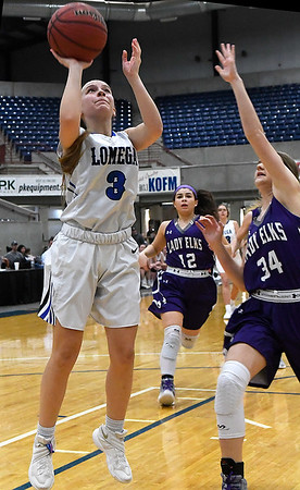 Lomega's Courtney Fox scores a basket against Burlington's Kayli Stewart during the championship game of the Cherokee Strip Conference Tournament Saturday january 26, 2019. (Billy Hefton / Enid News & Eagle)