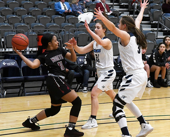 Enid's Ashley Handing and Claire Dodds pressure Putnam City North's Kyarra Crigler Tuesday january 29, 2019 at the Central national Bank Center. (Billy Hefton / Enid News & Eagle)