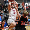 Chisholm's Noah Hann shoots over Fairview's Drew Houk during the first round of the Wheat Capital Tournament Thursday January 10, 2019 at Chisholm High School. (Billy Hefton / Enid News & Eagle)