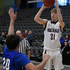 Pioneer's Eli Frazee shoots over Covington-Douglas' Calab Dalrymple during the first round of the Skeltur Conference Tournament Thursday January 24, 2019 at the Central National Bank Center. (Billy Hefton / Enid News & Eagle)