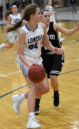 Lomega's Emma Duffy drives to the basket against Timberlake's KaLynn FeForce during a semi-final game of the Cherokee Strip Conference Tournament Friday January 25, 2019 at the Chisholm Trail Expo Center. (Billy Hefton / Enid News & Eagle)