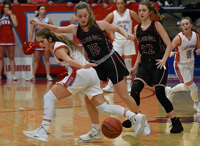 Holland Hall's Joci Laka knocks theball away from Chisholm's Briley Yunker during the championship game of the Wheat Capital Tournament Saturday January 12, 2019 at Chisholm High School. (Billy Hefton / Enid News & Eagle)