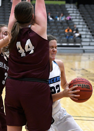 Enid's Cayti Moeller runs into Blackwell's Lyndi Jobe Friday January 18, 2019 at the Central National Bank Center. (Billy Hefton / Enid News & Eagle)