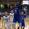 Covington-Douglas' Gloire Houmba puts up a shot in the lane against Pioneer during the first round of the Skeltur Conference Tournament Thursday January 24, 2019 at the Central National Bank Center. (Billy Hefton / Enid News & Eagle)