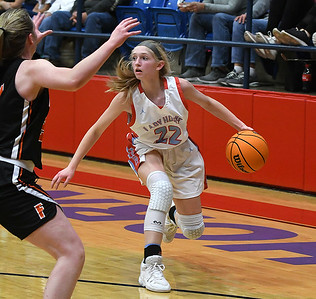 Chisholm's Alice Watkins looks for an opening against Fairview's Ally Robinson during the first round of the Wheat Capital Classic Basketball Tournament Thursday, January 2020 at Chisholm High School. (Billy Hefton / Enid Nwes & Eagle)