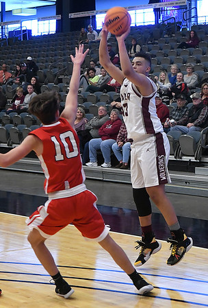 Garber's Taya Sullivan shoots over Dover's Diego Lopez during the first day of the 96th Skeltur Conference Basketball Tournament at the Stride Bank Center Thursday, January 23, 2020. (Billy Hefton / Enid News & Eagle)