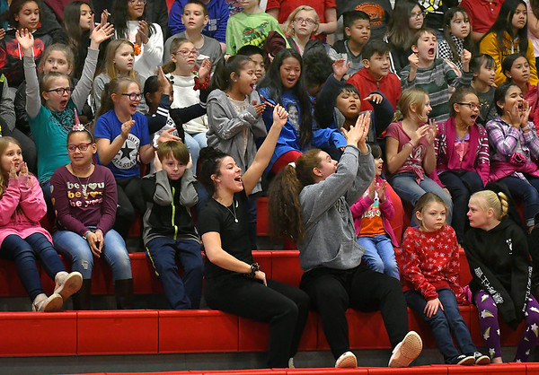 NOC Enid women basketball players, Abbey Phibby and Madelyn Hankins, lead the cheers with elementary school students during Education Day as the NOC Enid men played Mid American Christian University Monday, January 6, 2020 at the NOC Mabee Center. (Billy Hefton / Enid News & Eagle)