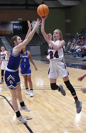 Garber's Alyssa Johnson shoots over Waukomis' Taylor Wieden during the championship game of the 96th Skeltur Conference Basketball Tournament Saturday, 25, 2020 at the Stride Bank Center. (Billy Hefton / Enid News & Eagle)