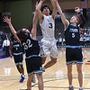Enid's Cyson Mathis shoots against OKC Storm's Stephen Lawson and Cooper Peterson Tuesday, January 14, 2020 at the Stride Bank Center. (Billy Hefton / Enid News & Eagle)