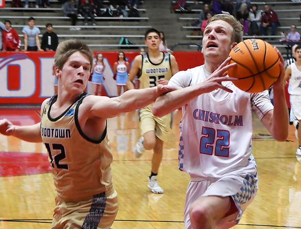 Chisholm's Heston Daniels is fouled by Woodward's Jack McClung during the second day of the Wheat Capital Classic Basketball Tournament Friday, January 10, 2020 at Chisholm High School. (Billy Hefton / Enid Nwes & Eagle)