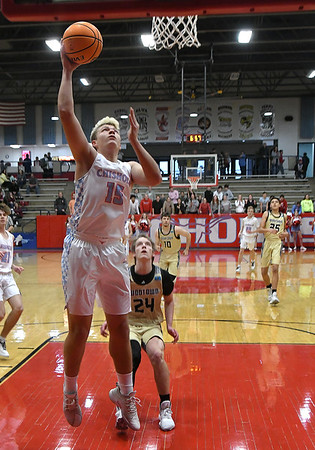 Chisholm's Nate Edwards scores a basket against Woodward during the second day of the Wheat Capital Classic Basketball Tournament Friday, January 10, 2020 at Chisholm High School. (Billy Hefton / Enid Nwes & Eagle)