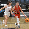 Chisholm's Tatum Sefcik is pressured by Cashion's Kaitin Taylor as she dribbles upcourt during the Downtown Basketball Festival Friday, January 31, 2020 at the Stride Bank Center. (Billy Hefton / Enid News & Eagle)